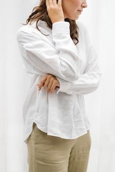 Brown hair woman in white shirt