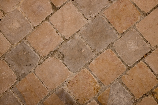 Brown interlocking paving stone driveway from above