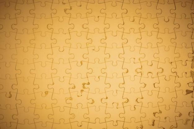 茶色のジグソーパズルの背景。