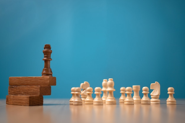 Brown king chess standing on a wooden stand. the concept of leaders in good organizations must have a vision