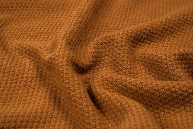 Коричневый узор трикотажной ткани. теплая одежда.