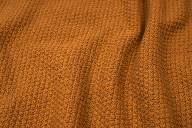 Brown knitted fabric pattern.