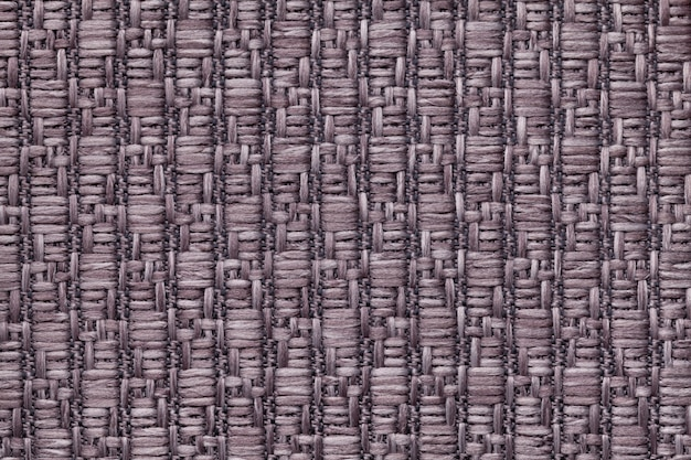 Brown knitted woolen background with a pattern of soft, fleecy cloth  texture of textile closeup