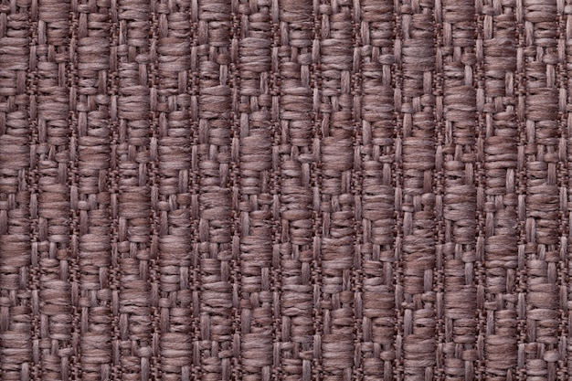 Brown knitted woolen background with a pattern of soft, fleecy cloth. texture of textile closeup.