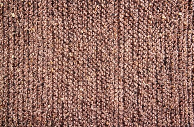 Текстура шерсти коричневого вязания для фона