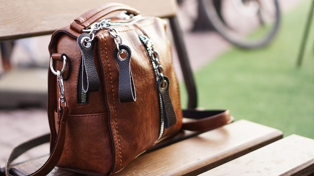 Brown leather bag outside