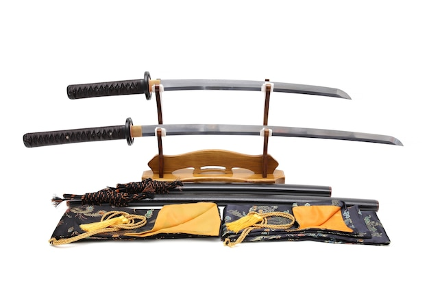 Brown leather cord japanese sword with black scabbard on wooden stand and bag