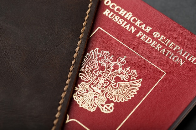 Brown leather cover with a red passport