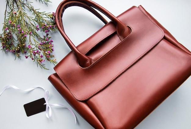 Brown leather ladies bag flowers and blank tag