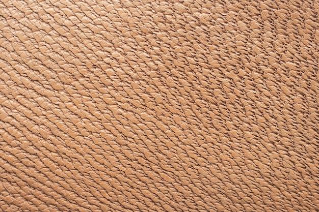 茶色の革テクスチャ背景をクローズアップ