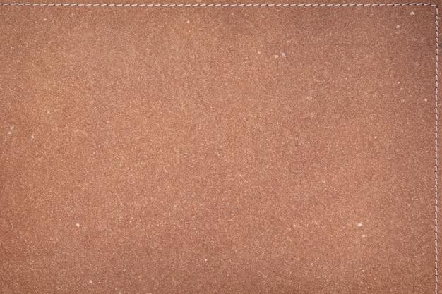 Коричневая кожаная текстура фоновой поверхности или кожзаменителя