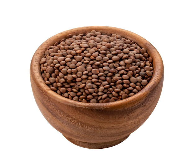 Brown lentils in wooden bowl isolated