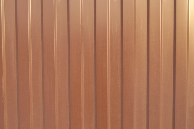 Brown metal siding, modern finishing material for the manufacture of fences and exterior wall