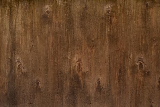 ノットと茶色の古い木材のテクスチャ