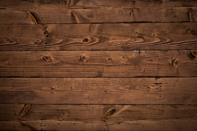 Brown old wooden wall with horizontal planks, rustic boards texture