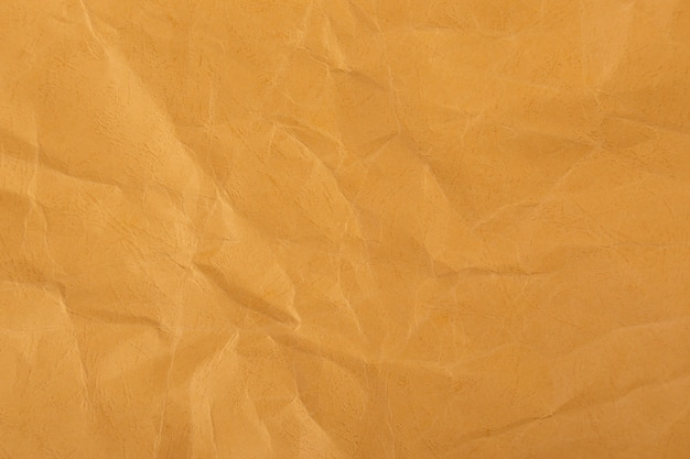 Коричневая или желтая морщинка рециркулирует бумажный фон.