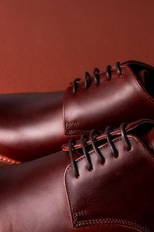 Brown oxford shoes on red . close up.