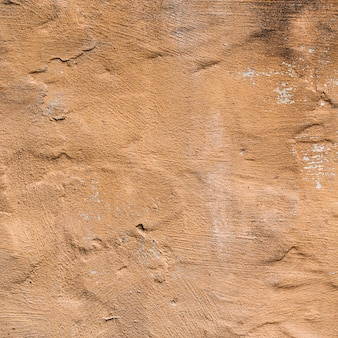 Brown painted wall texture with cracks