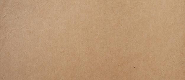 茶色の紙の背景とコピースペースを持つテクスチャー