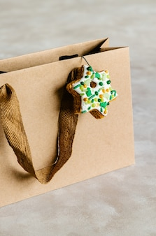 Brown paper bag decorated with gingerbread cookie