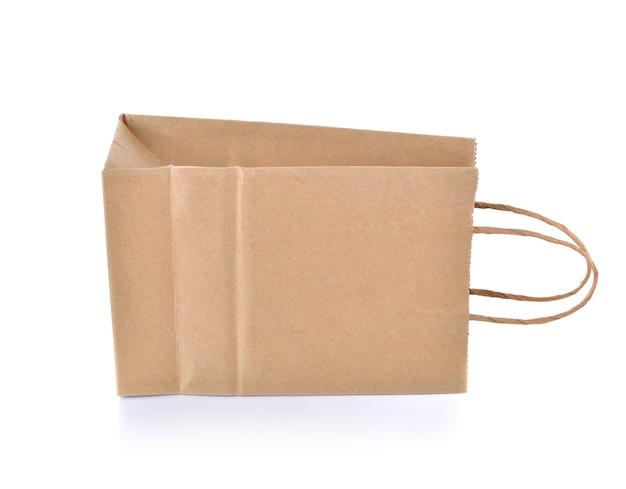 Коричневый бумажный пакет на белой стене