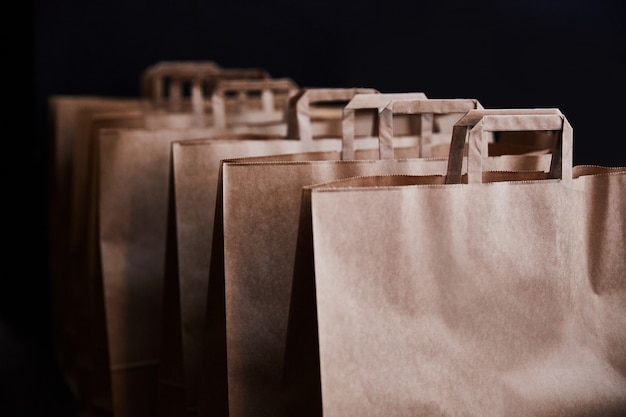 Brown paper bags on a black background