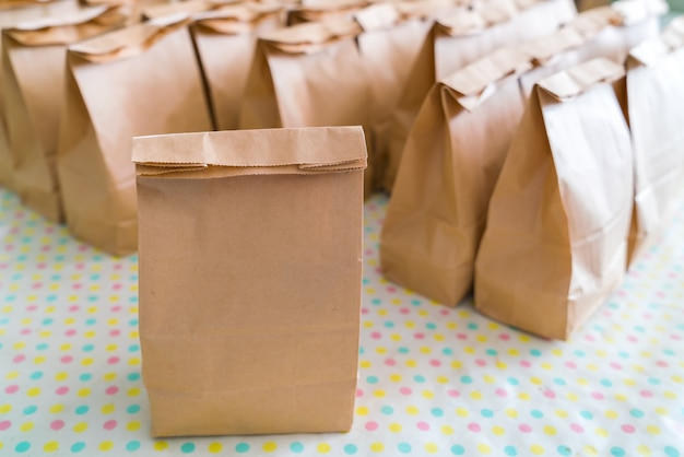 Brown paper bags on table .