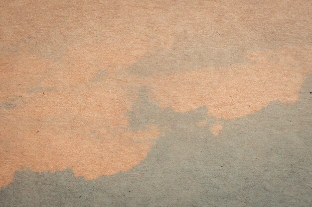 Brown paper and blue water colour texture and background with space.