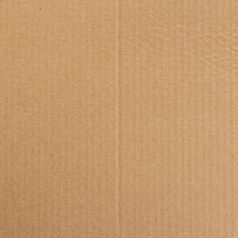 Brown paper box or corrugated cardboard sheet texture background