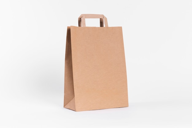 Brown paper carrier bag for shopping with handles