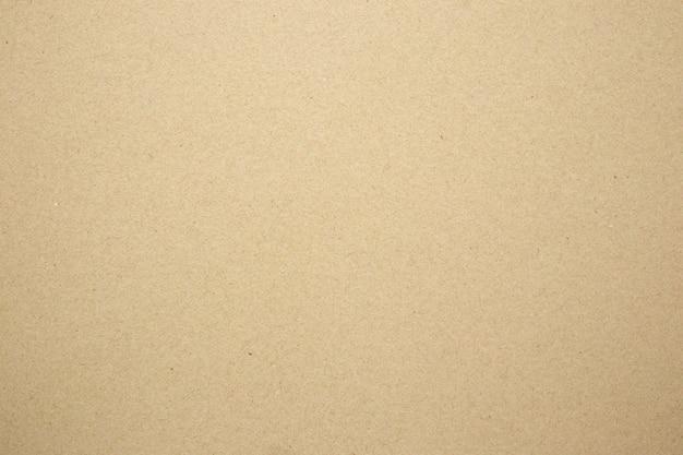 茶色の紙エコリサイクルクラフトシートテクスチャ段ボールの背景