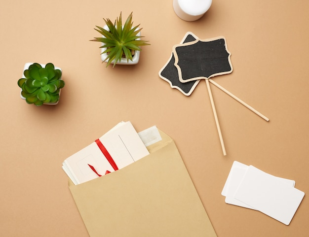 Brown paper envelope and empty wooden pointer