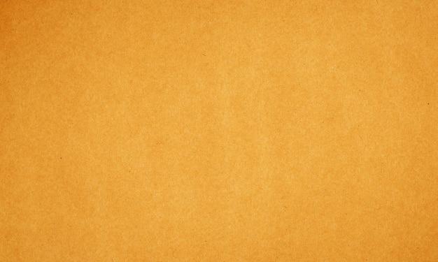 Текстура коричневой бумаги или картона для фона.