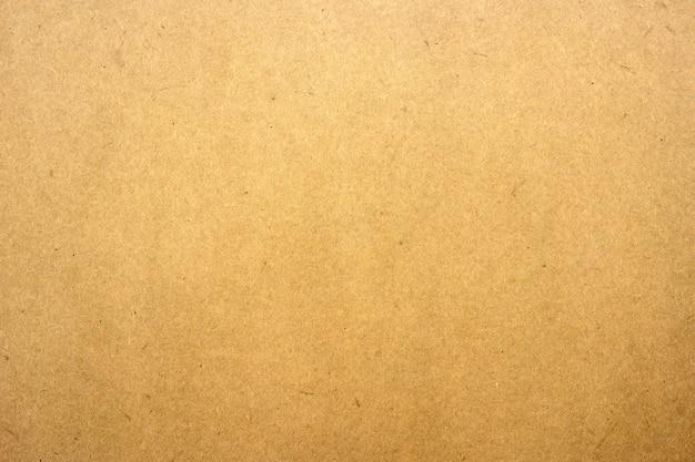 Текстура коричневой бумаги или картона для поверхности.