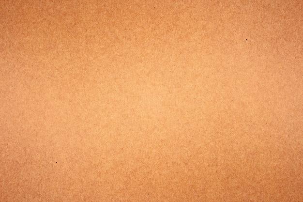 Текстура коричневой бумаги или картона для поверхности