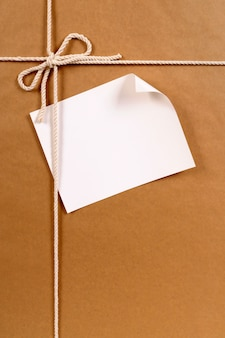 Brown paper package with curled label