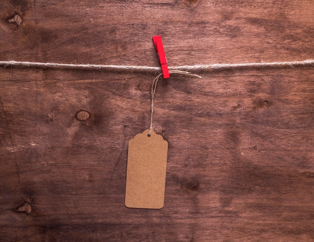 Brown paper tag hanging on a rope