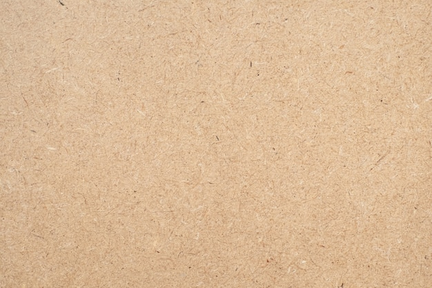 Brown paper texture background or cardboard surface