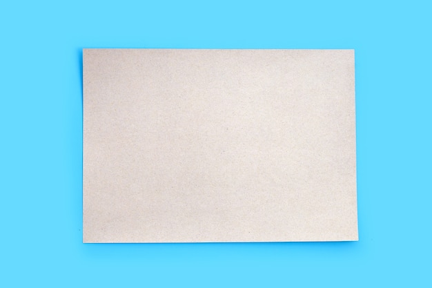 Brown paper texture on blue background.