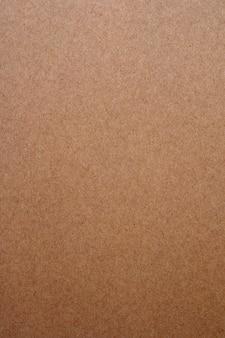 Текстура коричневой бумаги для фона.