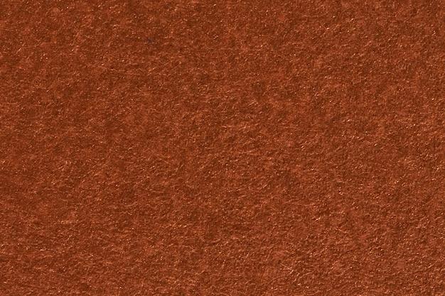 背景として最適な茶色の紙の質感。高解像度の写真。