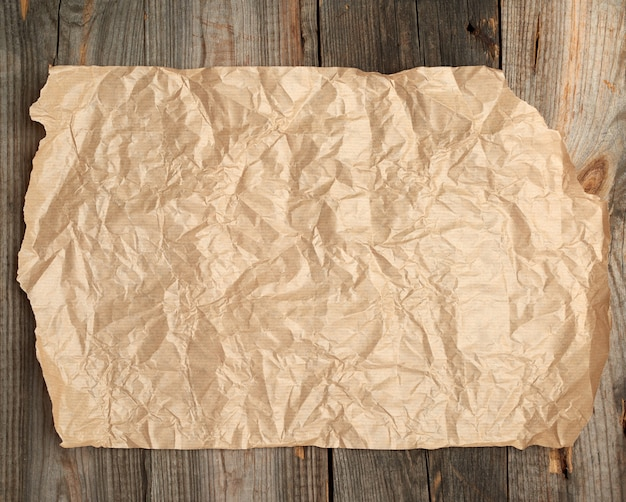 Brown paper on a wooden surface from old boards