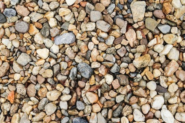 Коричневая галька камень или речной каменный фон