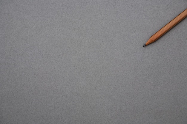 Brown pencil on grey background