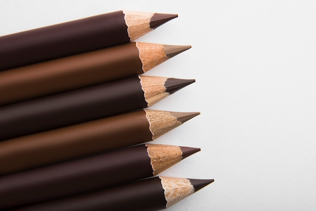 Brown pencils isolated on white background