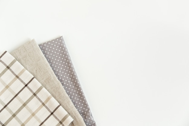Brown plaid tablecloth and grey napkin rough cloth towel ,dotted on the  top view