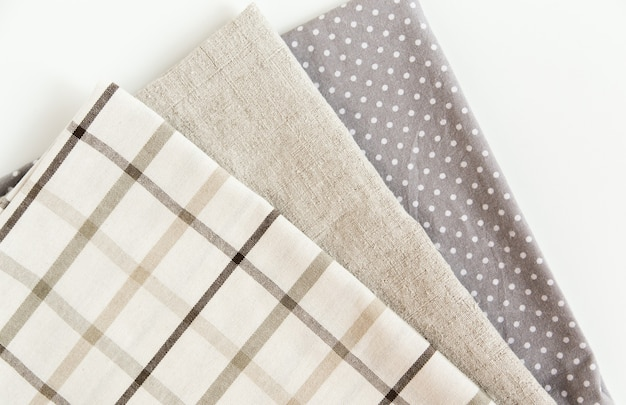 Brown plaid tablecloth and grey napkin rough cloth towel  and dotted on the  top view