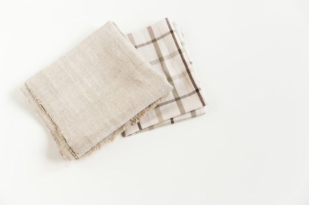 Brown plaid tablecloth and grey napkin rough cloth towel