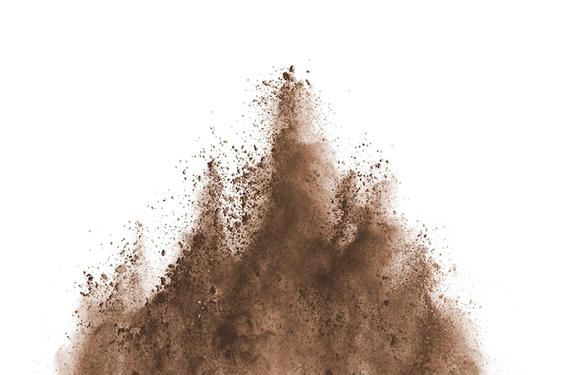 Brown powder explosion isolated on white