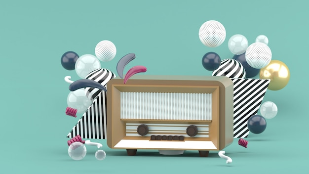 青にカラフルなボールに囲まれた茶色のラジオ。 3dレンダー